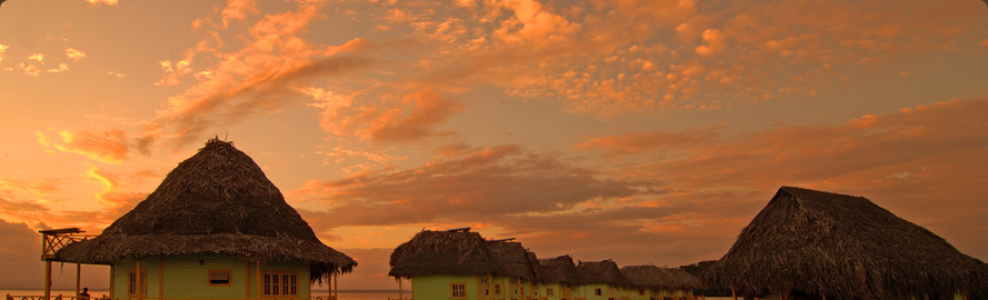 Overwater cabins in Bocas del Toro at sunset