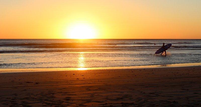 Surfing during the golden hour at San Juan del Sur, Nicaragua