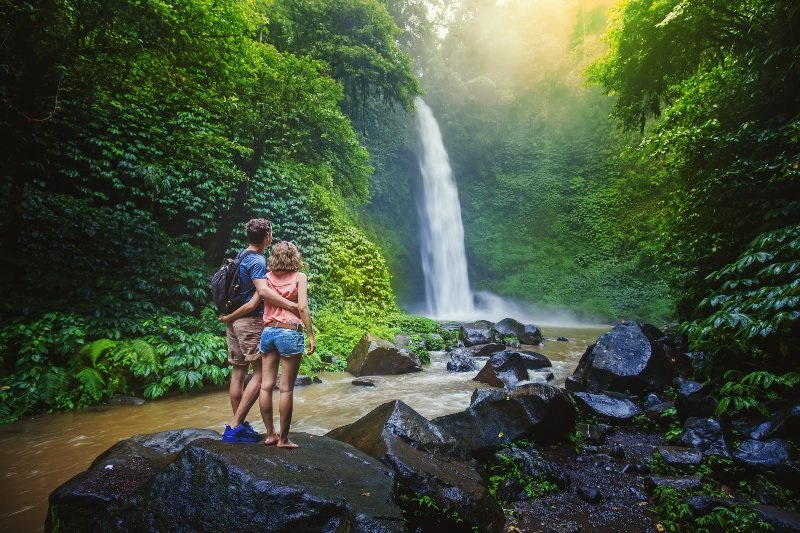 Alone time at a jungle waterfall on a Central America Honeymoon